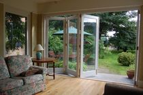 wooden fold-and-slide patio door  Kingsbridge Joinery