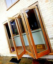 wooden fold-and-slide patio door RUBBEN BESPOKE Rubben UK