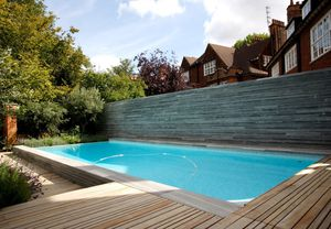 in ground swimming pool concrete overflow outdoor