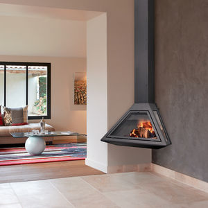 woodburning fireplace closed hearth corner
