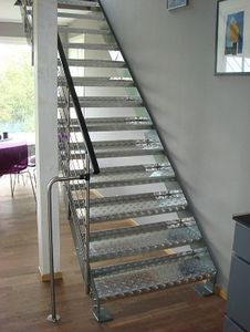 Straight staircase / lateral stringer / and glass frame / with a metal and steps