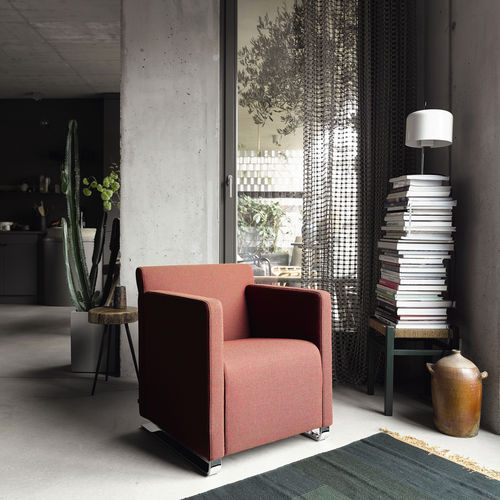 minimalist design lounge chair / textile / leather / swivel