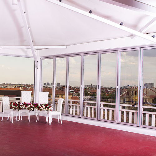sliding patio door / folding / aluminum / double-glazed
