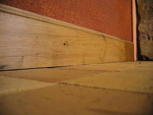 oak baseboard / in reclaimed material
