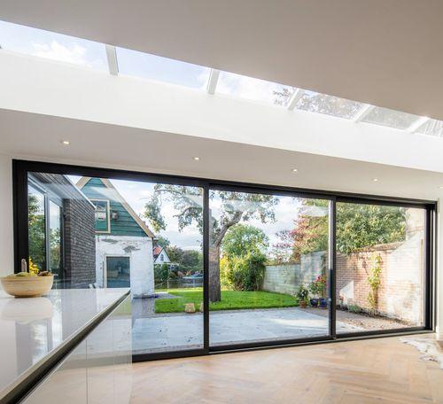 sliding patio door / aluminum / triple-glazed / thermally-insulated