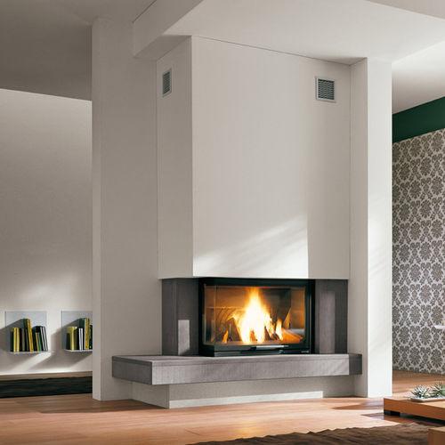 contemporary fireplace surround / stone / corner
