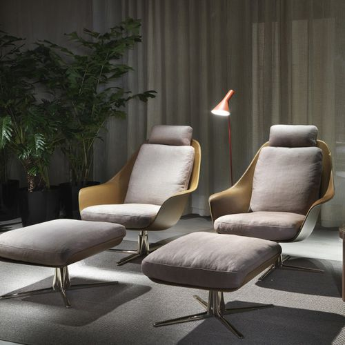 contemporary armchair / fabric / leather / metal