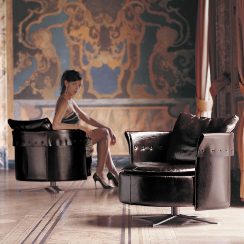 contemporary armchair / fabric / leather / star base