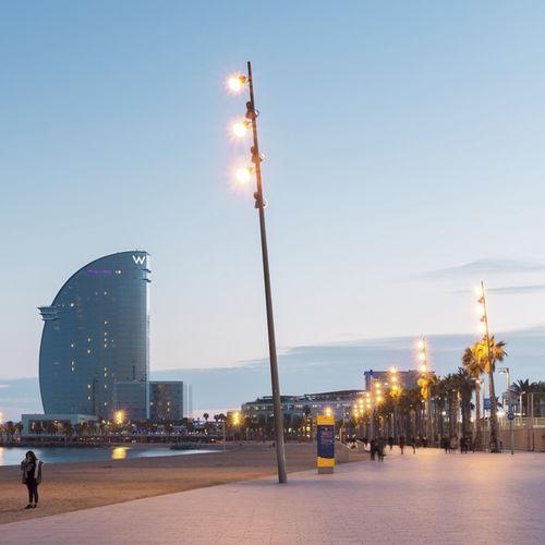 Urban lamp post / design / stainless steel / COR-TEN® steel KANYA by Miquel Roig, Olga Tarrasó, Jordi Henrich Escofet