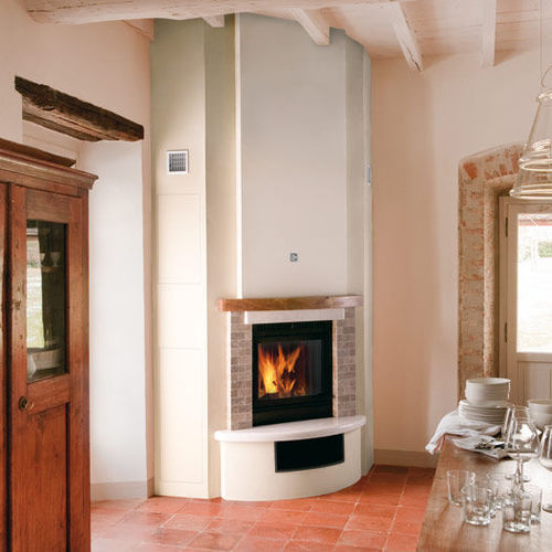 contemporary fireplace surround / marble / wooden / corner