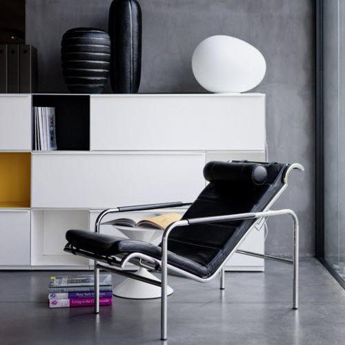 contemporary armchair / leather / steel / polyurethane