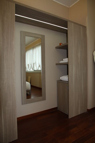hotel wardrobe / contemporary / wooden / sliding door