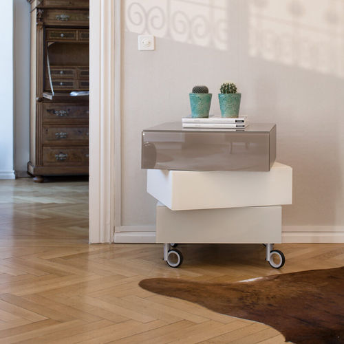 contemporary chest of drawers / lacquered wood / glass / on casters