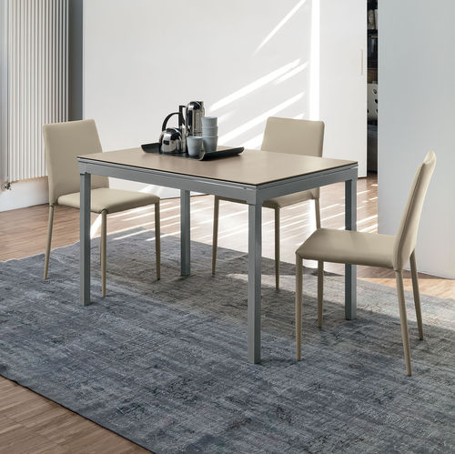 contemporary dining table / MDF / tempered glass / painted metal