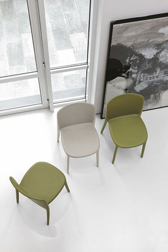 contemporary chair / upholstered / polyurethane / leather