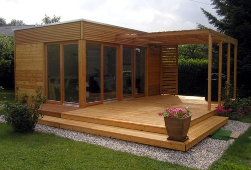 modular house / individual / contemporary / solid wood