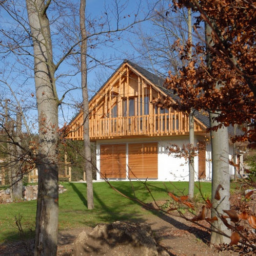 wooden solar shading / for facades / vertical / rigid