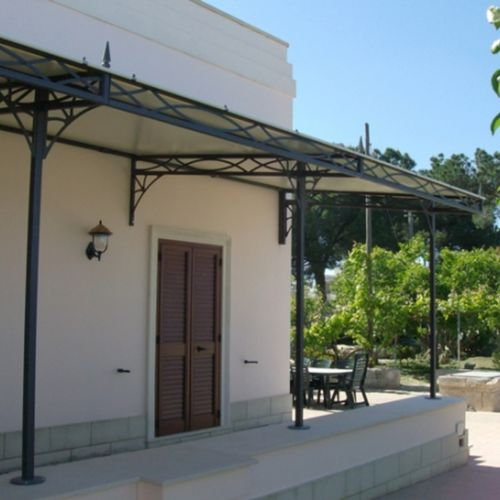 wall-mounted pergola / steel / fabric canopy / commercial