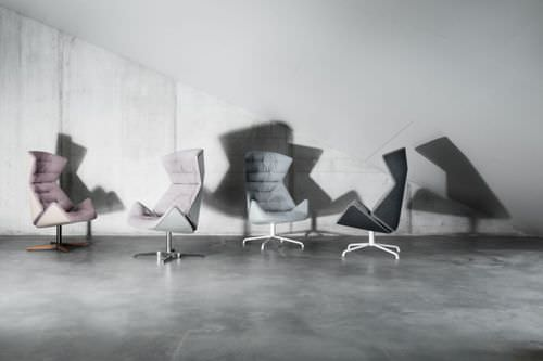 Contemporary armchair / with footrest / swivel / wing 808 by Formstelle THONET