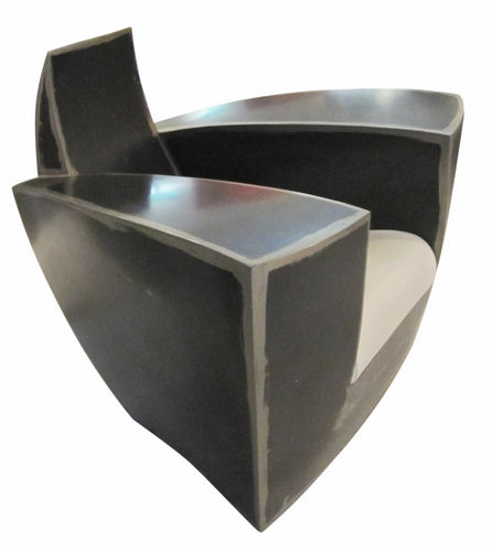 original design armchair / leather / steel / with concealed casters