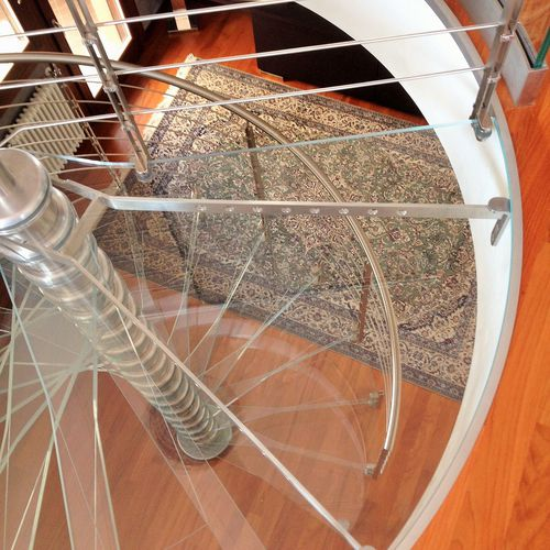 spiral staircase / stainless steel frame / glass steps / contemporary