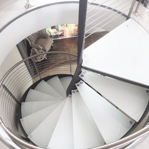 spiral staircase / metal frame / glass steps / without risers