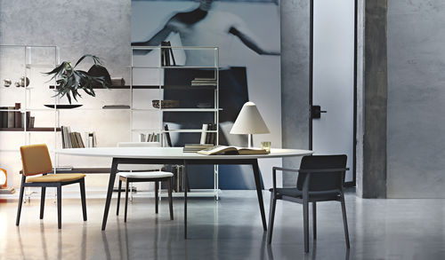 contemporary table / metal / lacquered wood / oval