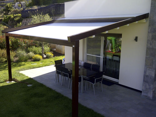 Wall-mounted pergola / aluminum / fabric sliding canopy / custom A2 COMPACT KE Outdoor Design