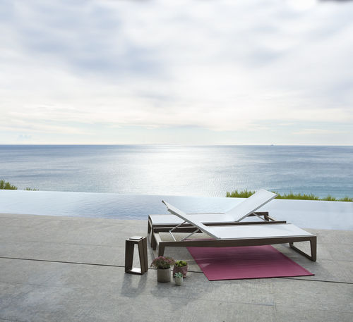 contemporary sun lounger / Batyline® / teak / commercial