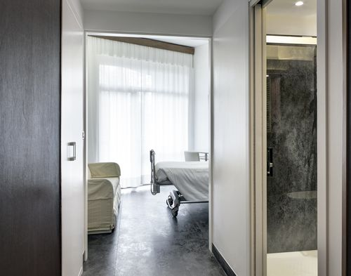 Ceramic floor covering / for hospitals / high-gloss / metal look OXIDE: NERO LAMINAM