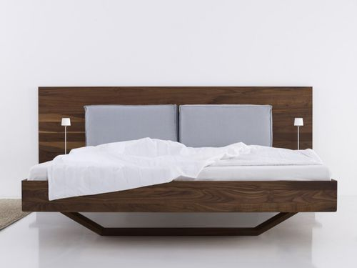 double bed / contemporary / with upholstered headboard / wooden