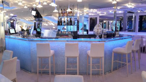 bar counter / glass / L-shaped / illuminated