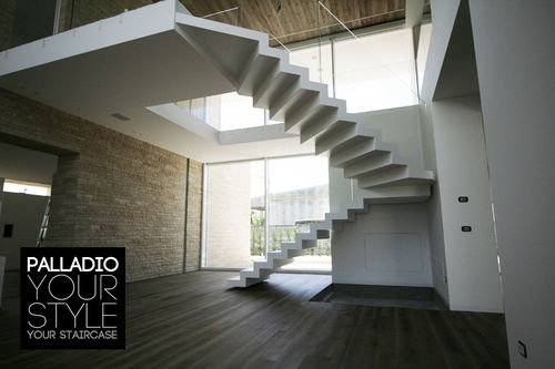 Half-turn staircase / glass steps / wooden steps / with risers PALLADIO SAGOMATA art surface corian and glass PALLADIO SCALE
