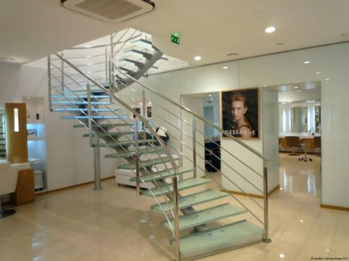 circular staircase with central stringer for commercial buildings (metal frame and glass steps) ELCDES la stylique