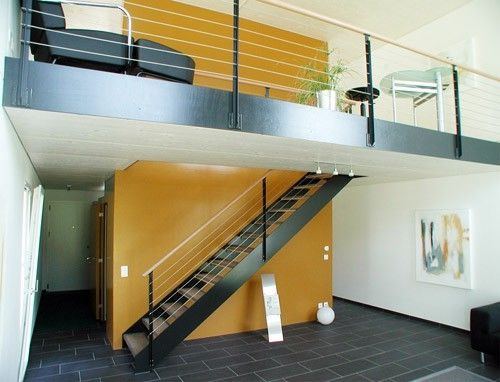 straight staircase with a lateral stringer (metal frame and wood steps) Haring Engineering Ltd