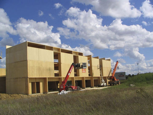 wooden contemporary ecological prefab building for housing development THIONVILLE EN FRANCE HMS Bausysteme