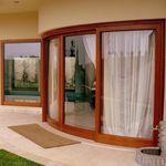 Lift-and-slide patio door / wooden / aluminum / double-glazed S.15 Panda Windows & Doors