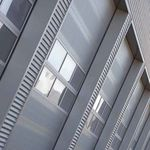 tilting window / stainless steel / for commercial buildings