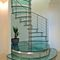 Spiral staircase / glass steps / metal frame / without risers SPIRAL VISION Delineo