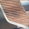 contemporary sun lounger / pine / powder-coated steel / for public spaces