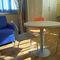 contemporary side table / wooden / round / for hotels