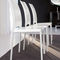 contemporary chair / with armrests / upholstered / metal