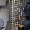 geometric curtain / pleated / aluminum / stainless steel