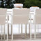 contemporary garden chair / sled base / with armrests / with removable cushion
