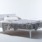double bed / contemporary / with upholstered headboard / fabric