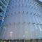 metal solar shading / glass / for facades / vertical