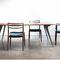 contemporary dining table / cast aluminum / walnut / oak