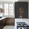 contemporary kitchen / lacquered wood / natural stone / island