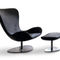 contemporary fireside chair / fabric / leather / with footrest
