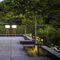 floor-standing lamp / contemporary / stainless steel / teak